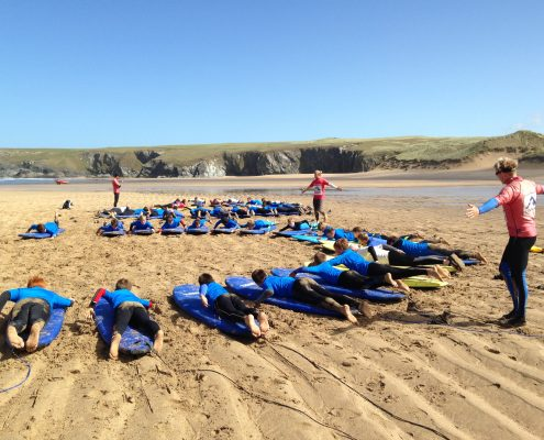 kids surfing with Cornwall Surf Academy