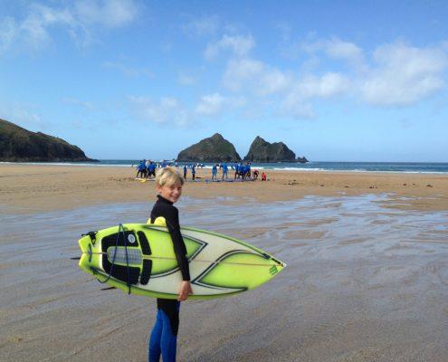 kid goes surfing