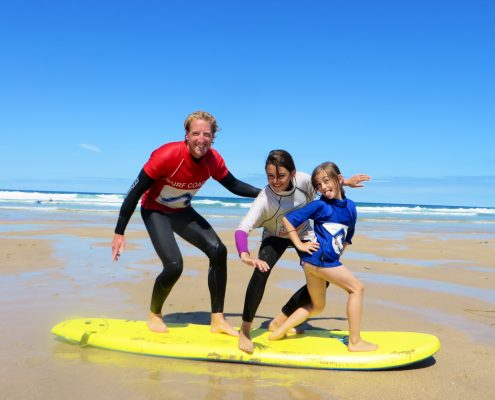 dan coaching students to surf