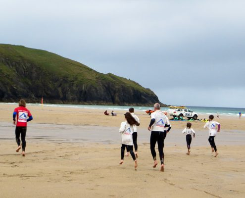 running on Holywell Bay before surf